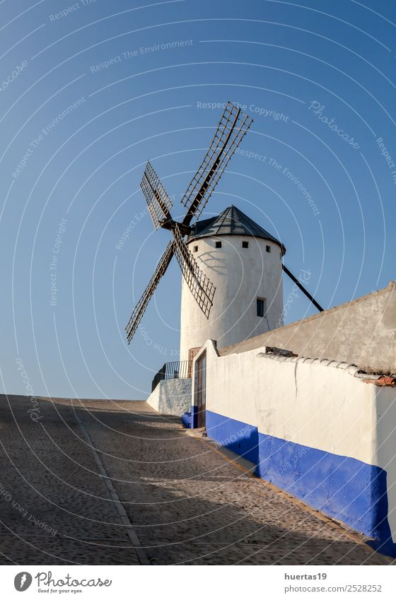 Spanish windmill Vacation & Travel Wind Hill Building Architecture Tourist Attraction Monument Lanes & trails Old Historic Blue Windmill construction cornet