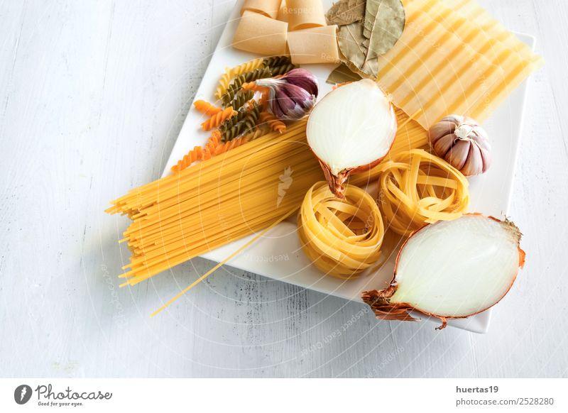 Raw Italian pasta Healthy Eating Green Yellow Food Crockery Plate Horizontal Italian Food Spaghetti Garlic Olive oil