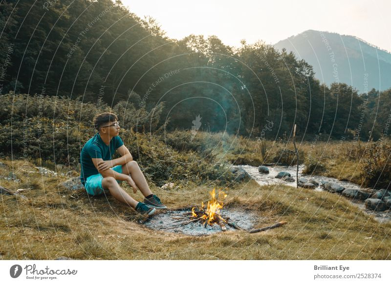 Campfire Melancholy Lifestyle Camping Masculine Young man Youth (Young adults) 1 Human being 13 - 18 years Nature Warmth Meadow Brook River Think Sit Simple