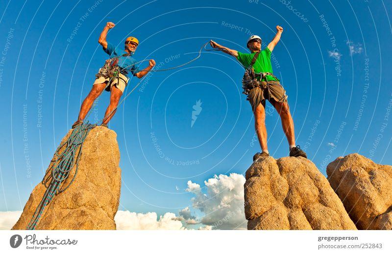 Rock climbing team standing on the summit. Human being Man Adults Sports Power Rope Success Climbing Trust Peak Brave Athletic Balance Top Teamwork Willpower