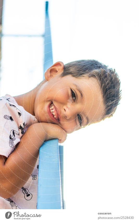 Little boy leaning on a railing in a white and blue village Child Human being Vacation & Travel Summer Blue Beautiful White Joy Face Lifestyle Happy Boy (child)