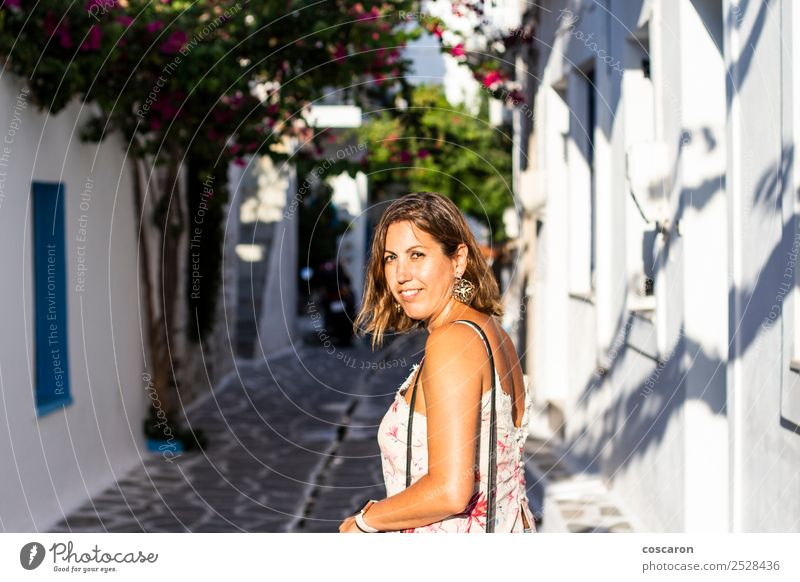 Middle aged woman on the streets of a greek village Woman Human being Vacation & Travel Old Summer Blue Town Beautiful White Flower