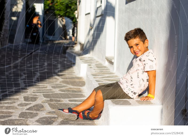 Little boy seated on a stone bench. Vacation & Travel Tourism Summer Island House (Residential Structure) Landscape Flower Village Town Building Architecture
