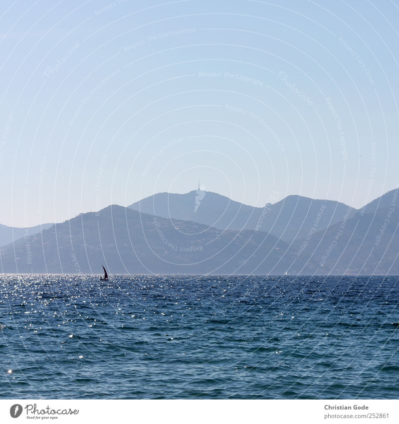 Sky Nature Water Blue Sun Vacation & Travel Summer Beach Ocean Far-off places Freedom Environment Landscape Air Coast Lake