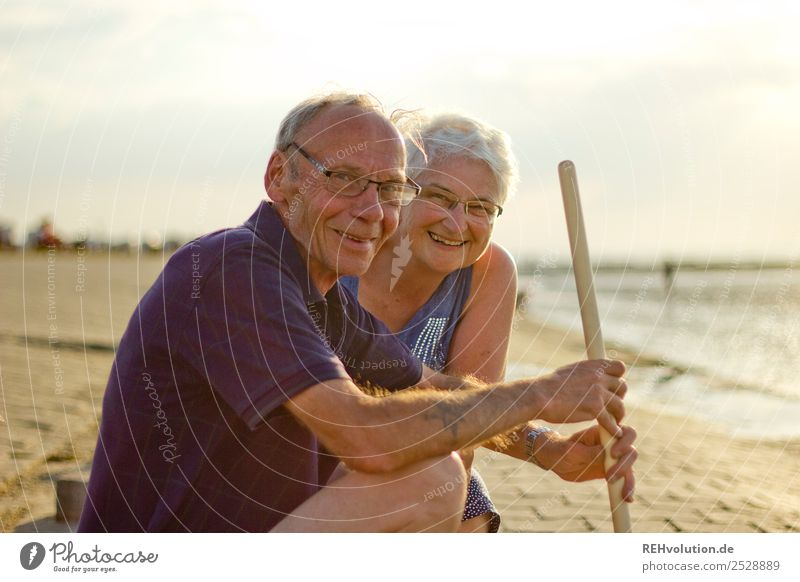Laughing pensioner couple at the seaside Healthy Life Contentment Relaxation Calm Leisure and hobbies Vacation & Travel Summer Summer vacation Beach Ocean