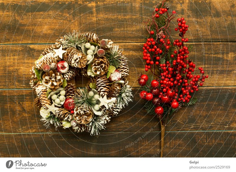 Delicate Christmas wreath of pine cones on wooden background Fruit Apple Luxury Design Winter Snow Decoration Feasts & Celebrations Christmas & Advent Autumn