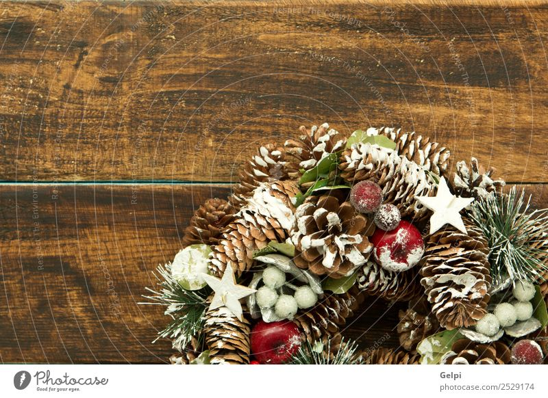 Delicate Christmas wreath of pine cones on wooden background Christmas & Advent Beautiful White Red Winter Snow Feasts & Celebrations Fruit Decoration