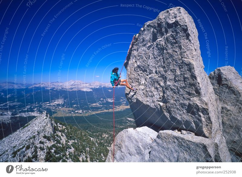 Female climber rappelling. Human being Woman Loneliness Adults Sports Life Power Success Adventure Rope Climbing Athletic Brave Joie de vivre (Vitality) Balance Attempt