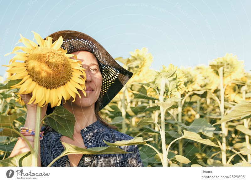 woman among the sunflowers Lifestyle Happy Tourism Adventure Human being Feminine Woman Adults Female senior 1 45 - 60 years Nature Landscape Plant Clouds