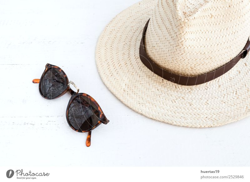 Sunglasses and hat Lifestyle Shopping Elegant Style Design Relaxation Vacation & Travel Tourism Hat Adventure holidays passport documents Things Straw hat