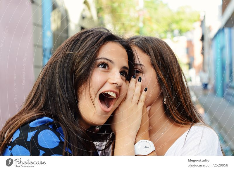Two best friends shares secrets. Lifestyle Joy Happy Beautiful Face Summer To talk Woman Adults Friendship Mouth Listening Smiling Together Funny Cute Surprise