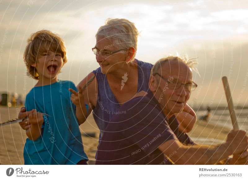 Grandma and grandpa with grandchildren by the sea Vacation & Travel Summer vacation Sun Beach Ocean Human being Boy (child) Female senior Woman Male senior Man