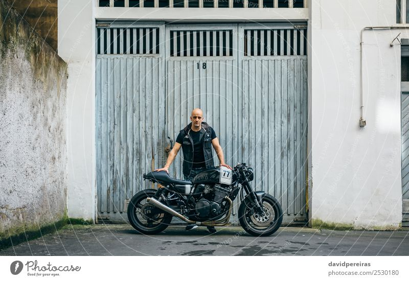 Builder posing with a motorcycle Lifestyle Style Trip Engines Human being Man Adults Street Vehicle Motorcycle Bald or shaved head Stand Authentic Retro Black