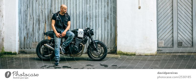 Biker posing with a motorcycle Lifestyle Style Engines Human being Man Adults Street Vehicle Motorcycle Bald or shaved head Smiling Sit Authentic Retro Black