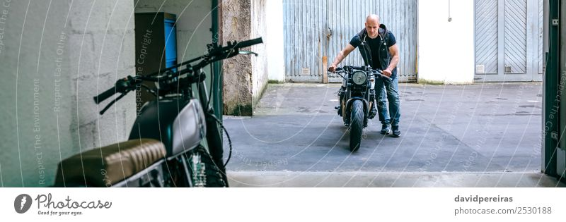 Biker taking motorbike to the garage Lifestyle Style Vacation & Travel Trip Engines Human being Man Adults Street Vehicle Motorcycle Bald or shaved head Stand