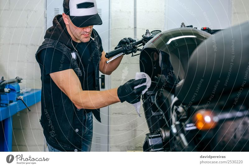 Mechanic cleaning a motorcycle Lifestyle Style Work and employment Engines Human being Man Adults Vehicle Motorcycle Cloth Authentic Bright Retro Black vintage