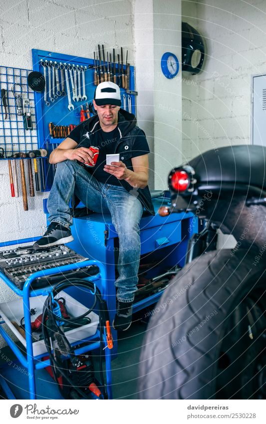 Motorcycles mechanic resting having a beer Drinking Beer Lifestyle Style PDA Engines Human being Man Adults Vehicle Sit Authentic Retro break mobile Workbench