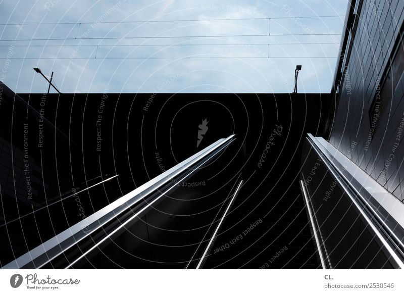 escalator Sky Beautiful weather Town Downtown Deserted Building Architecture Wall (barrier) Wall (building) Stairs Escalator Dark Blue Black Movement