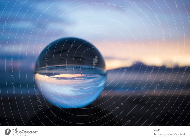 Sunset at Beach Through Glass Ball Design Beautiful Calm Ocean Waves Environment Nature Landscape Sand Sky Clouds Sphere Serene Peace Sustainability
