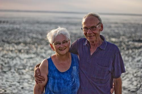 Seniors laugh in the watt Vacation & Travel Summer Summer vacation Beach Ocean Human being Masculine Feminine Woman Adults Man Female senior Male senior Couple