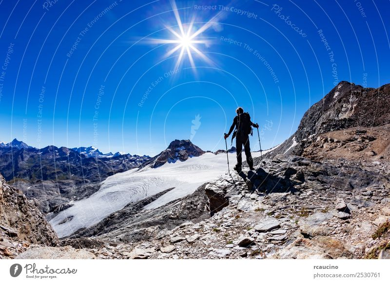 Hiker reaches a high mountain pass, Italian Alps Vacation & Travel Adventure Expedition Summer Sun Mountain Hiking Sports Success Man Adults Nature Landscape