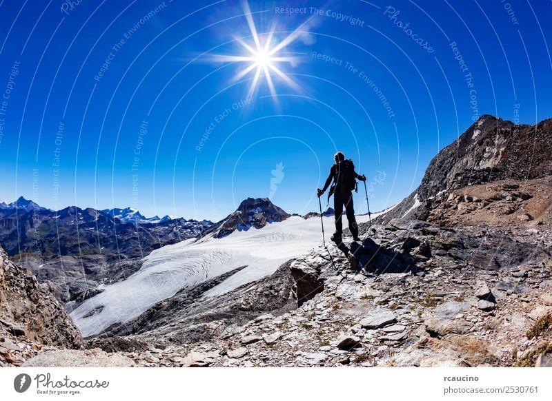 Hiker reaches a high mountain pass, Italian Alps Vacation & Travel Adventure Expedition Summer Sun Mountain Hiking Sports Success Man Adults Nature Landscape