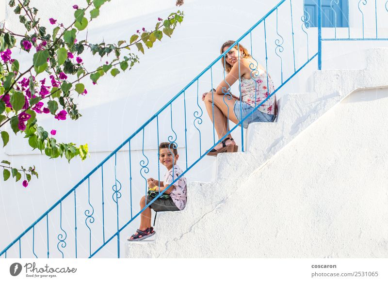Mother and son on a white stairs with a blue railing Woman Child Human being Plant Blue Beautiful White Flower House (Residential Structure) Joy Black Lifestyle