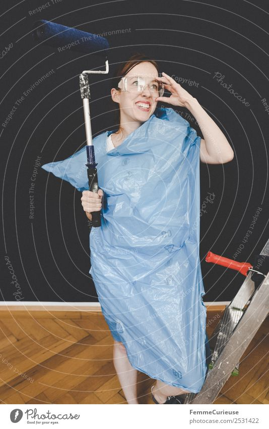 Woman in protective clothes posing with a blue paint roller #DIY Leisure and hobbies Feminine Adults 1 Human being 18 - 30 years Youth (Young adults) Resolve