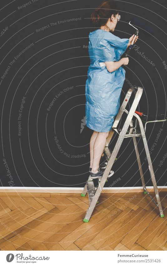 Woman in protective clothes coloring a wall with a paint roller Leisure and hobbies Feminine Adults 1 Human being 18 - 30 years Youth (Young adults)