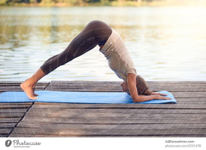 Attractive woman working out on a wooden deck Lifestyle Happy Body Wellness Meditation Summer Ocean Yoga Woman Adults 1 Human being 18 - 30 years