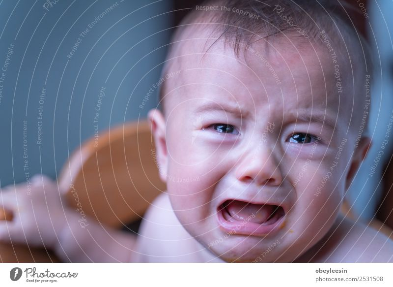 baby sitting sad and crying in the room Lifestyle Human being Head Face Eyes 1 0 - 12 months Baby Sit Colour photo
