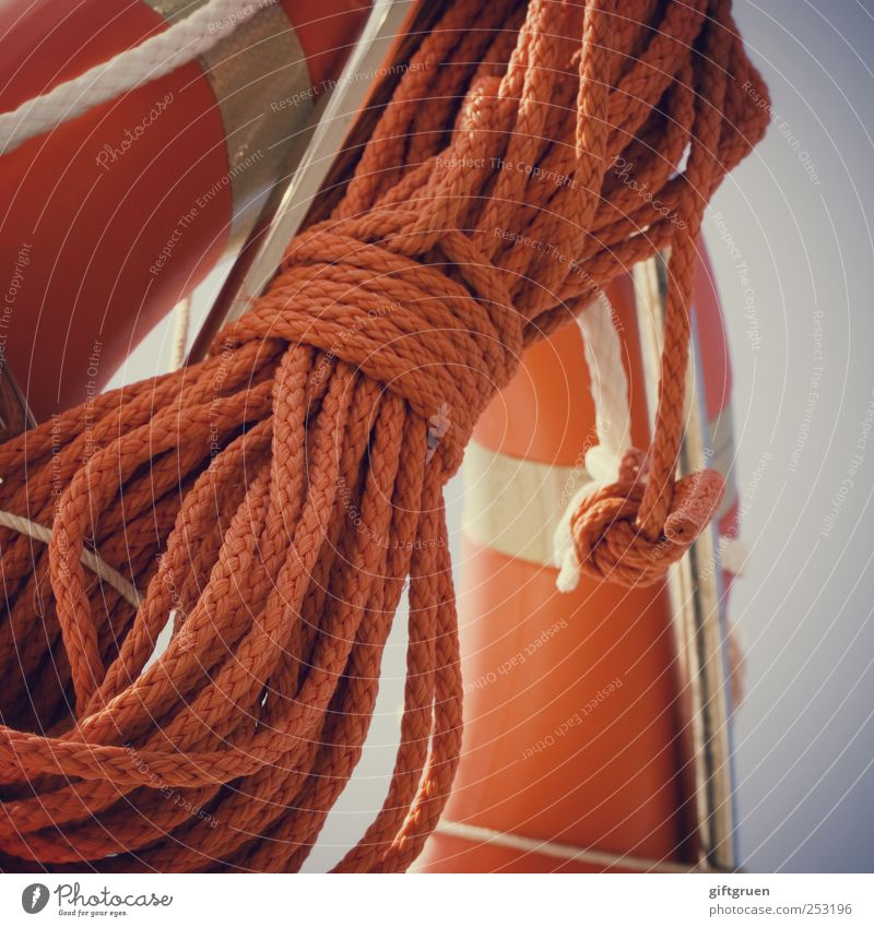 safe is safe Navigation Boating trip Passenger ship Safety Logistics Rescue Life belt Rope Knot Watercraft Risk Dangerous Orange boat accessories Colour photo