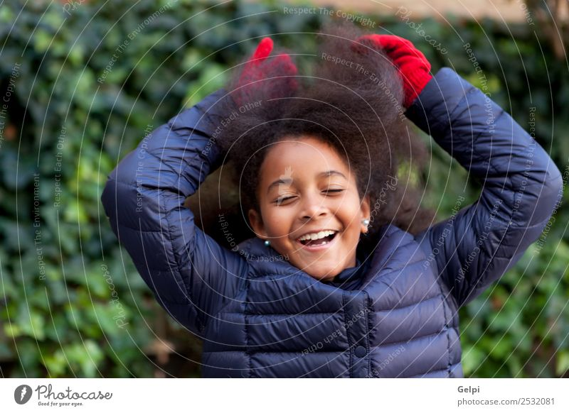 Pretty girl with long afro hair Happy Beautiful Face Winter Garden Child Human being Woman Adults Infancy Park Coat Brunette Afro Smiling Happiness Long Cute