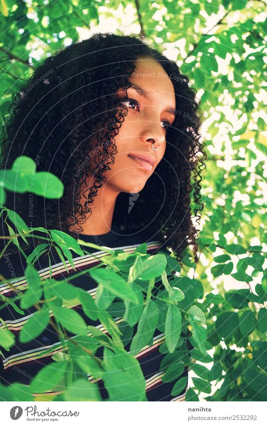 Young woman surrounded by green leaves Lifestyle Style Design Beautiful Hair and hairstyles Skin Face Human being Feminine Youth (Young adults) 1 18 - 30 years