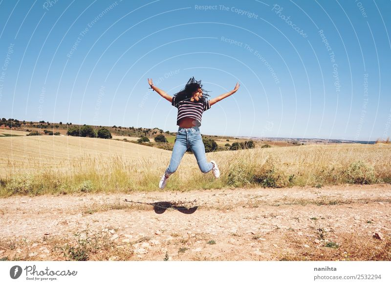 Young woman jumping in nature Lifestyle Style Joy Healthy Athletic Wellness Leisure and hobbies Vacation & Travel Adventure Freedom Human being Feminine