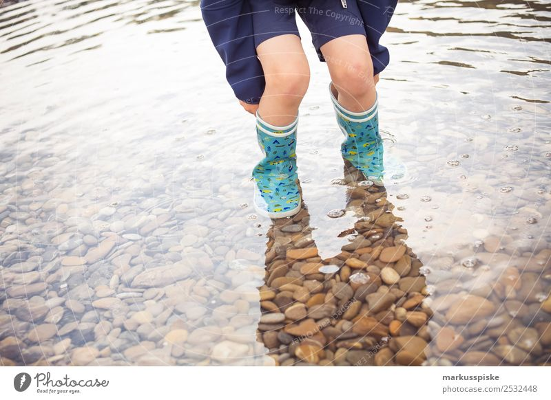 Boy with rubber boots in the water Leisure and hobbies Playing Vacation & Travel Tourism Trip Adventure Far-off places Freedom Expedition Camping Summer