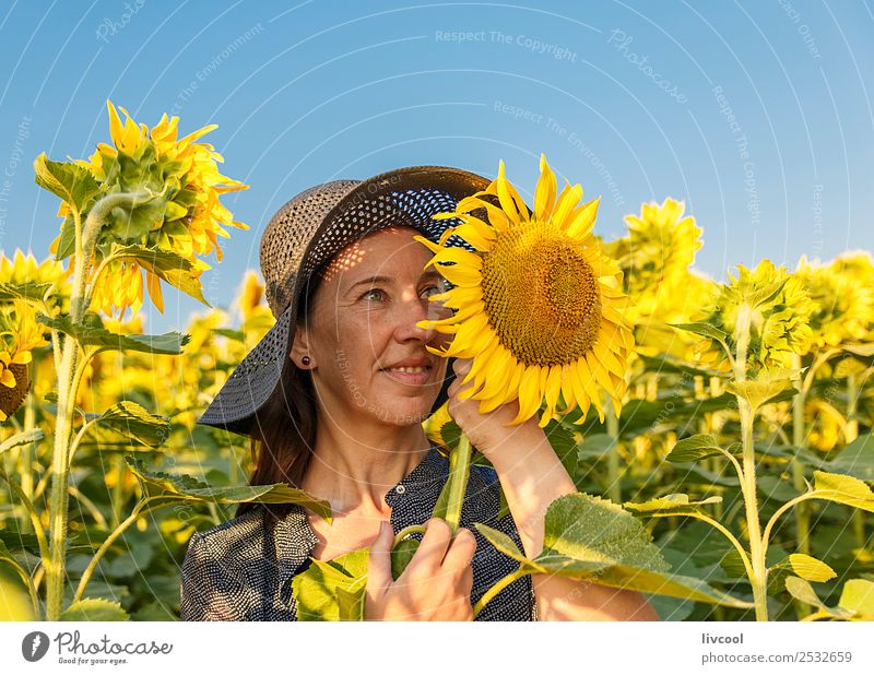 woman and sunflowers Lifestyle Happy Tourism Adventure Human being Feminine Woman Adults Female senior Head Face 1 45 - 60 years Landscape Plant Clouds Flower