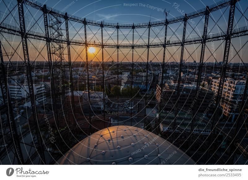 Sunset at the Gasometer Sky Cloudless sky Clouds Sunrise Sunlight Summer Beautiful weather Berlin Germany Europe Capital city Downtown Metal Steel Blue Yellow