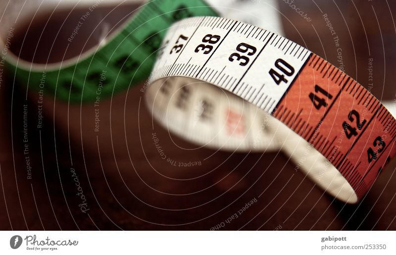 slimming craze Tailor Tailoring Tape measure Centimeter Unit of measurement Sewing Measure Meter Sign Characters Digits and numbers Old Retro Brown Red White