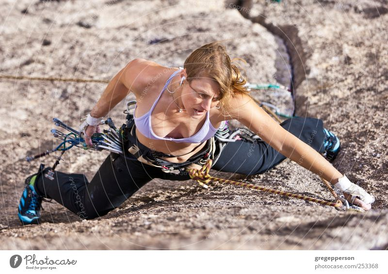 Female rock climber. Human being Woman Youth (Young adults) Adults Life Sports Power Adventure Success 18 - 30 years Climbing Trust Brave Athletic Joie de vivre (Vitality) Balance