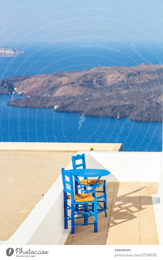 Little terrace with sea views in Santorini, Greece. Seafood Lunch Dinner Plate Design Beautiful Vacation & Travel Summer Ocean Island Chair Table Restaurant