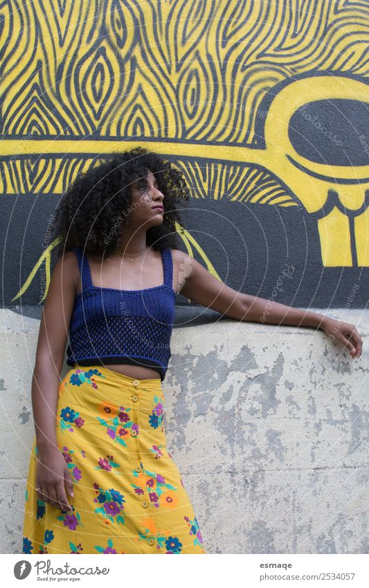 woman on the street with graffiti Human being Vacation & Travel Youth (Young adults) Young woman Town Lifestyle Yellow Natural Feminine Art Tourism Fashion