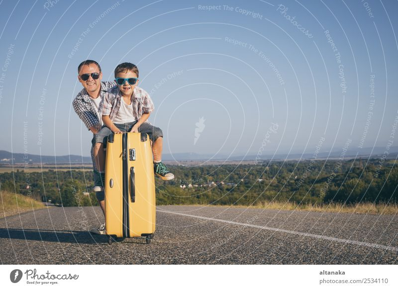 Father and son standing on the road at the day time. Lifestyle Joy Happy Playing Vacation & Travel Tourism Trip Adventure Freedom Camping Summer Hiking Sports