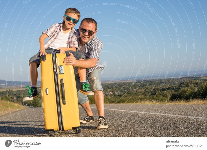 Father and son standing on the road at the day time. Concept of tourism. Lifestyle Joy Happy Playing Vacation & Travel Tourism Trip Adventure Freedom Camping