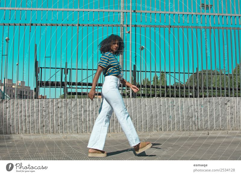 young woman walking on the street Lifestyle Exotic Joy Wellness Human being Feminine Young woman Youth (Young adults) 1 Village Small Town Fashion Clothing