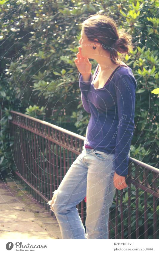 Serenity. Smoking Relaxation Feminine Young woman Youth (Young adults) 1 Human being 18 - 30 years Adults Bridge Bridge railing Jeans T-shirt Think Blue Violet