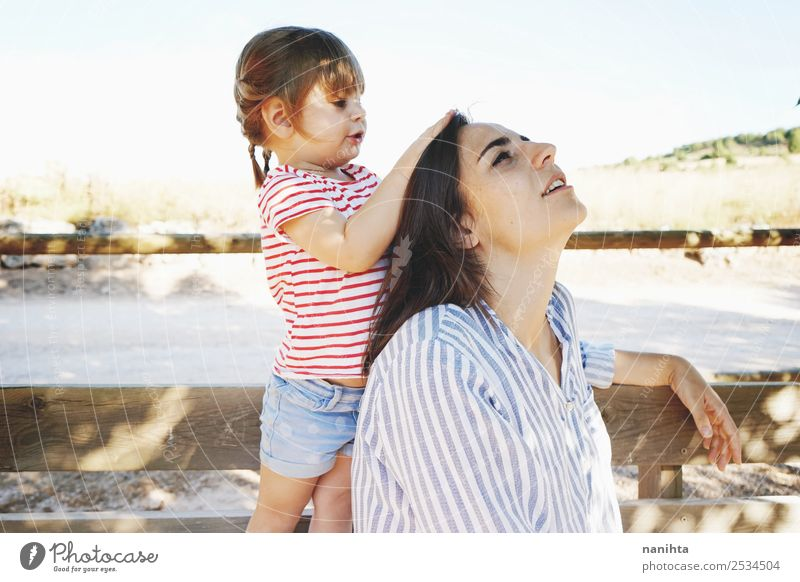 Little girl touching the head of her mom Lifestyle Style Joy Beautiful Hair and hairstyles Wellness Relaxation Human being Feminine Child Toddler Girl