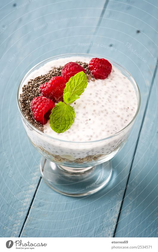 Chia yogurt with raspberries in a glass cup Healthy Eating Summer Food photograph Natural Fruit Nutrition Fresh Delicious Dessert Breakfast Seed Diet
