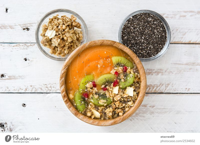 Smoothie with fruit,cereals and chia on white wooden table. Food Yoghurt Fruit Dessert Nutrition Breakfast Vegetarian diet Diet Healthy Healthy Eating Wood