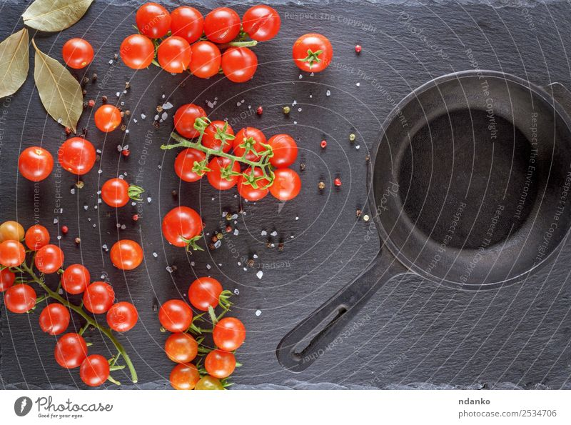 pan and fresh red ripe cherry tomatoes Vegetable Nutrition Lunch Vegetarian diet Pan Table Kitchen Eating Fresh Small Natural Above Green Red Black board branch